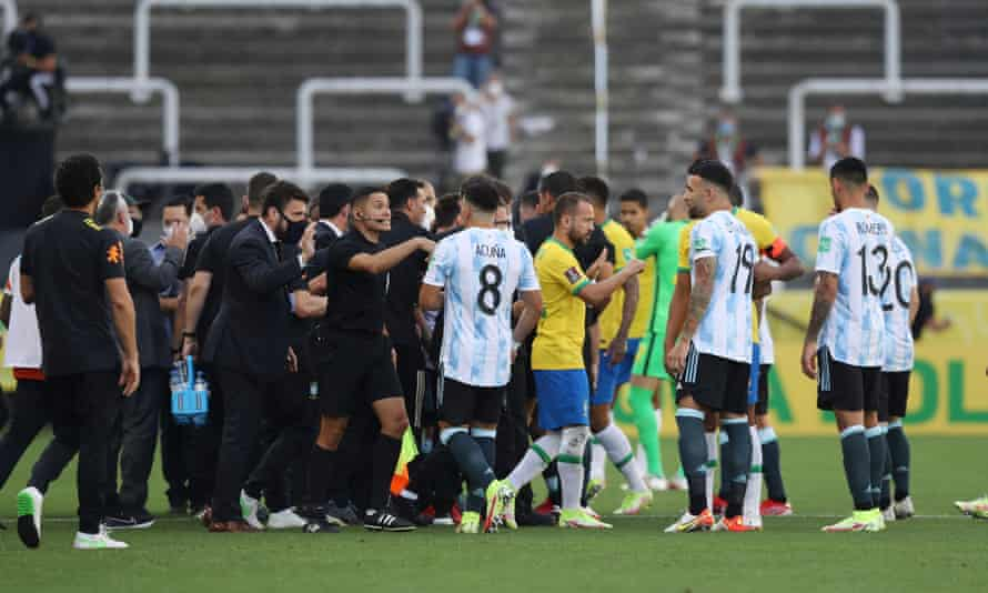 Chaos on the pitch as play is interrupted after Brazilian health officials objected to the participation of three Argentine players they say broke quarantine rules.