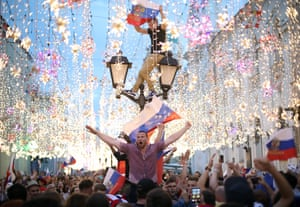 Moscow, Russia Fans celebrate Russia's victory in the 2018 FIFA World Cup Round of 16 match against Spain in Nikolskaya Street.