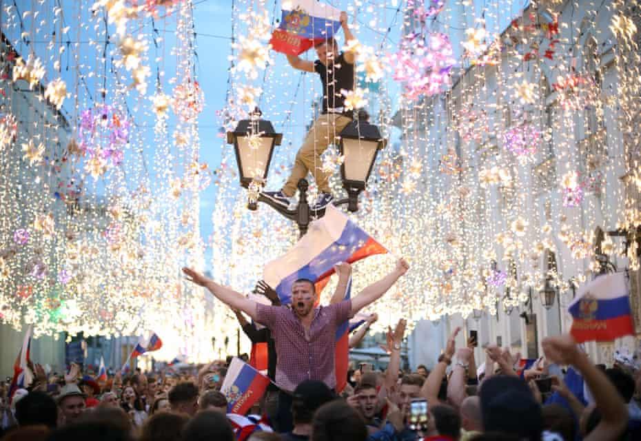 Fans in in Nikolskaya Street celebrate Russia's victory over Spain.