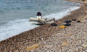 A refugee boat washed up on the beach on Chios, Greece.