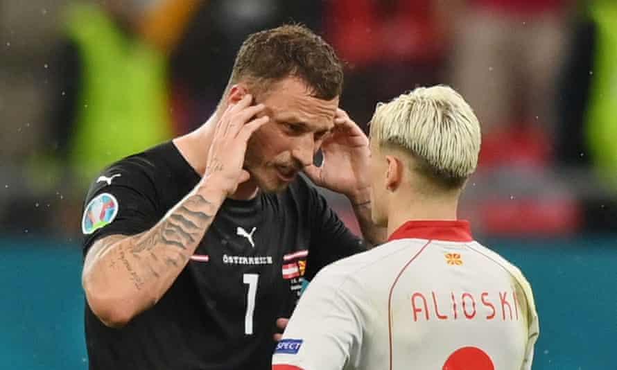 Austria's Marko Arnautovic and North Macedonia's Ezgjan Alioski after Monday's Euro 2020 match