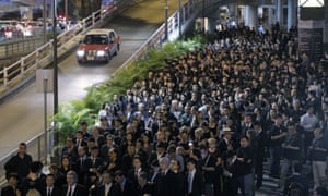 Lawyers take part in a silent protest march through downtown Hong Kong.