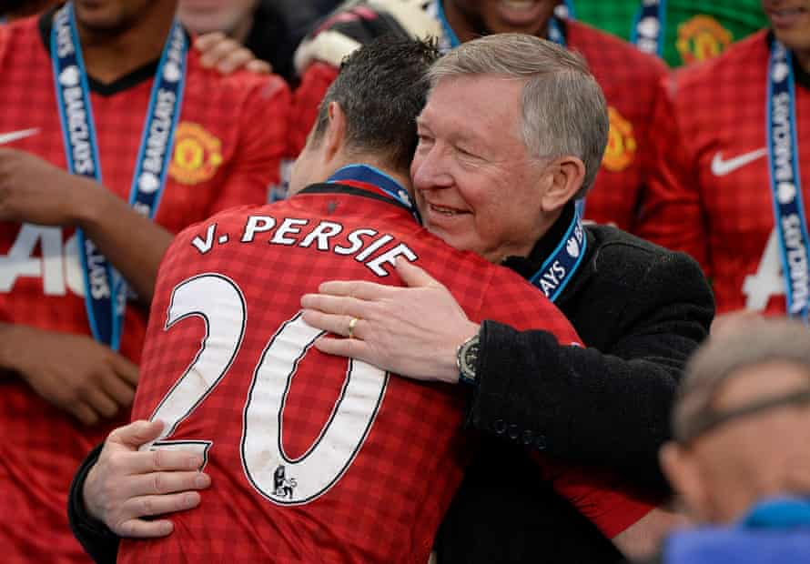 Alex Ferguson hugs Robin Van Persie at the trophy presentation after Manchester United won their 13th Premier League title under him.