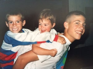 The teenage Foley with two of his younger siblings on his back.