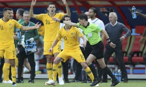 Australian players react angrily as the Uruguayan referee Andrés Cunha awards France a penalty after consulting the VAR during the sides' Group C match.