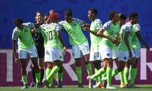 Asisat Oshoala (L) celebrates with teammates after scoring Nigeria's second goal.