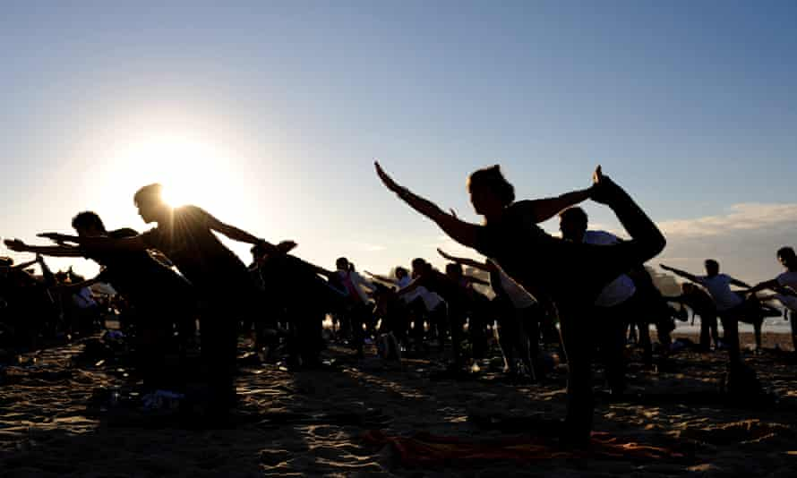 Five hundred and ninety-two yoga practitioners take part in a mass class on Bondi Beach in Sydney, 2009