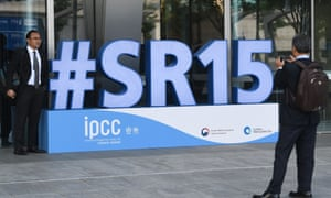 Attendees take a photo before the opening of the 48th session of the IPCC in Incheon