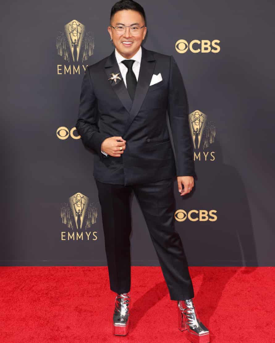 Bowen Yang arrives in Rancho Silver high platform-heel boots