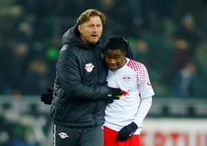 The Leipzig coach, Ralph Hasenhuettl, celebrates with Ademola Lookman after the Everton loanee snatched a very late win.