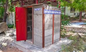A toilet building built using 'plastone' blocks.