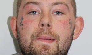 John Tomlin handed himself in an east London police station on Sunday.