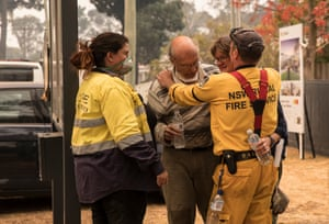 Brendon O'Connor, Rural Fire Service brigade captain for Balmoral, gives a local couple a hug who fear they have lost their house in the bushfires. They later find out their house was saved.