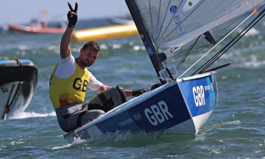 Giles Scott celebrates winning gold in the men's Finn