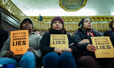 Anti-Amazon protesters at New York city hall. Photograph: Drew Angerer/Getty Images
