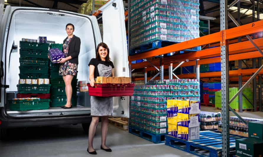 Fit to burst: Iseult Ward and Aoibheann O'Brien help out in FoodCloud's Irish distribution warehouse.