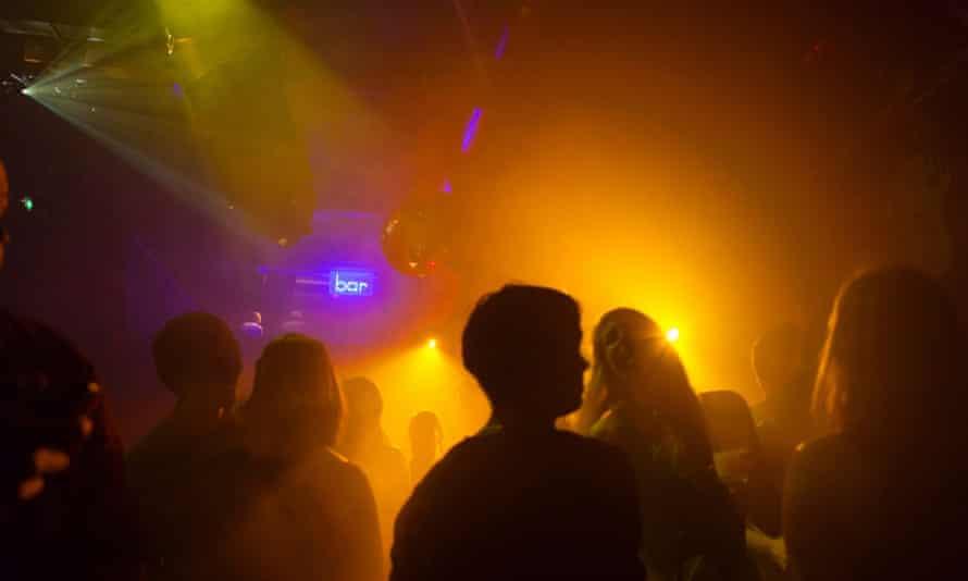Nightclub scene with people dancing