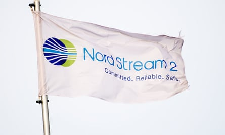 A flag reading 'Nord Stream 2'