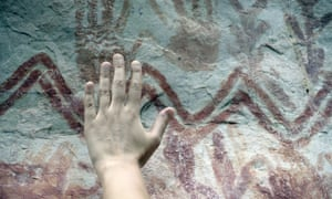 There are numerous hand prints among the images on the cliff face, similar to these at the nearby site of Cerro Azul.