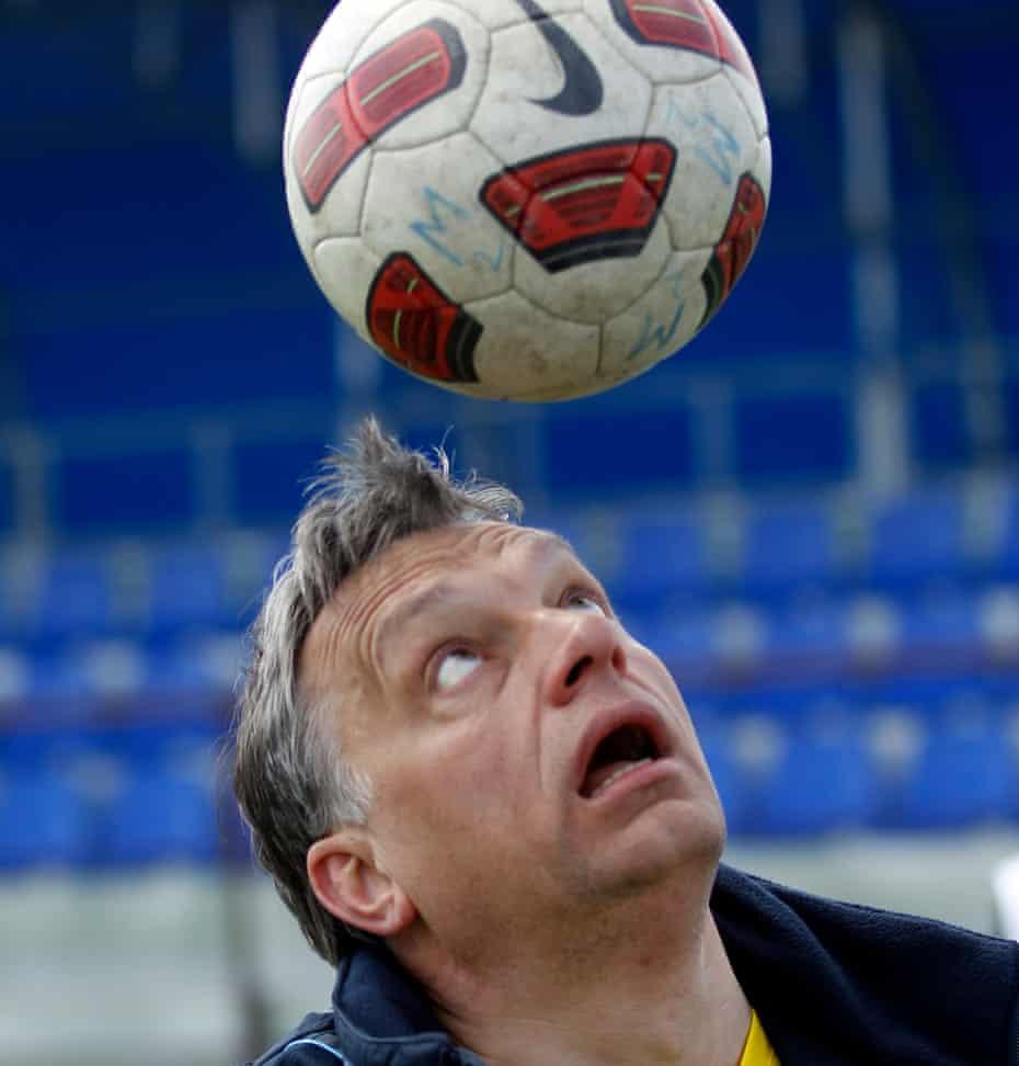 File photo of Hungarian Prime Minister Viktor Orban heading a football