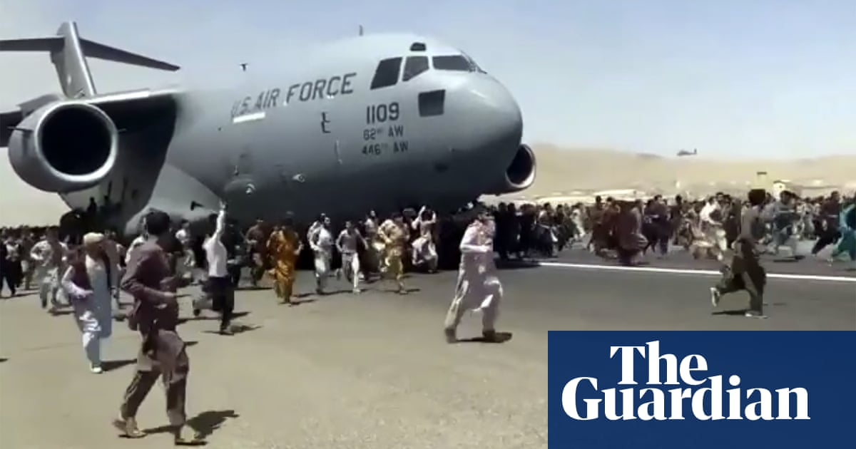 Chaotic scramble at Kabul airport as Taliban tightens grip on Afghanistan