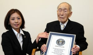 Sakari Momoi receives a certificate from Guinness World Records in 2014 naming him as the world's oldest man.