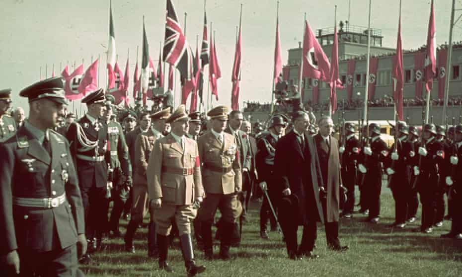 Neville Chamberlain (in black overcoat) on his way to a meeting with Adolf Hitler, 28 September 1938.
