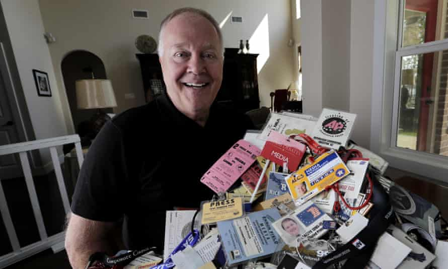 Veteran Associated Press reporter Michael Graczyk poses with some of many media credentials he has collected over his career
