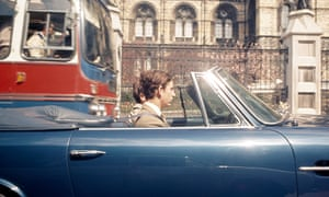 The Prince of Wales driving his Aston Martin in Kensington, London, in 1971.