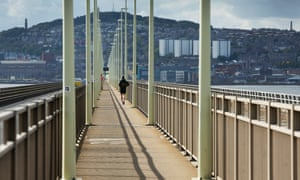 A runner passes over the Tay Road Bridge in Dundee.