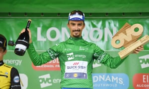 Julian Alaphilippe with the spoils of victory