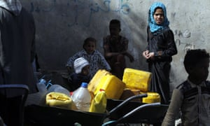 People queue to collect drinking water from a standpipe in Sana''a