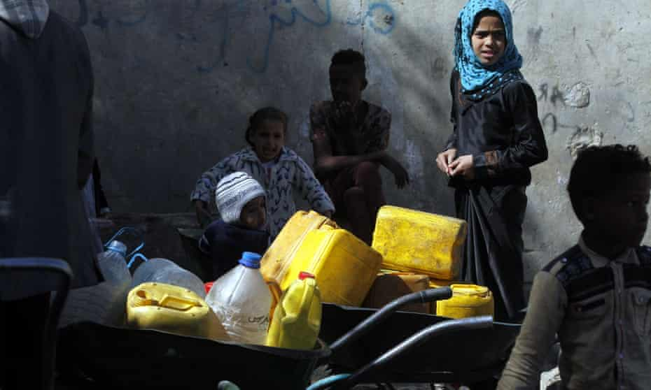 Yemenis wait to collect drinking water from a donated water pipe in Sana'a.