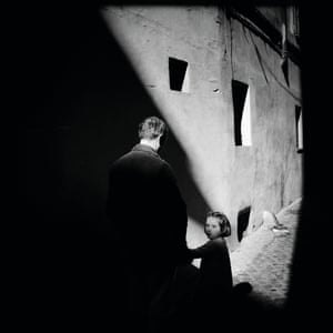 Looking Back: A child notices and questions the actions of the photographer as she waits for them to walk into shadow