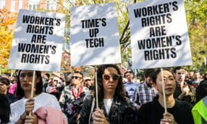 Workers hold signs outside across from Google's offices after walking out in New York.
