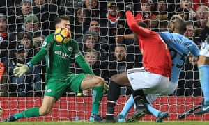 Action from last season's Manchester derby at Old Trafford.