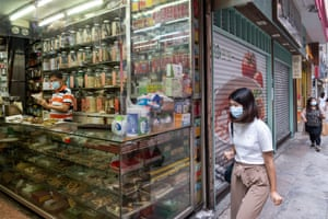 A Chinese medicine shop remains open to the public as many businesses in the vicinity have closed amid coronavirus restrictions in Tsim Sha Tsui, Hong Kong China, on 22 August 2020.