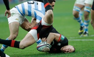 Mike Brown crashes his head into the turf after a dangerous tackle from Joaquin Tuculet who got a yellow card during the England v Argentina autumn international rugby union match at Twickenham