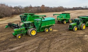 John Deere combines, tractors and grain bins in a harvested soybean field in Round Lake Heights, Illinois on Monday