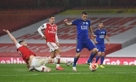Jamie Vardy scores Leicester's equaliser despite the efforts of the Arsenal defender Shkodran Mustafi.