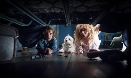 Noah Wiseman and Essie Davis check under the bed in the 2014 psychological horror The Babadook.