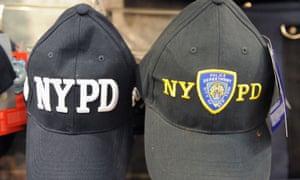 Caps bearing NYPD logos at a souvenir shop in New York.