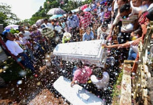 Relatives and friends of Jonathan and Eduardo, two youths killed during an alleged confrontation between police and members of organised crime, attend their funeral in Amatlan de los Reyes