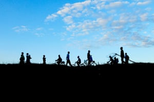Workers walk home at the end of the day in Machinga, Malawi