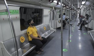 Commuters use Delhi Metro, which serves the Indian capital and adjoining areas, as it resumed operations at 50% capacity in New Delhi, India, on 7 June.
