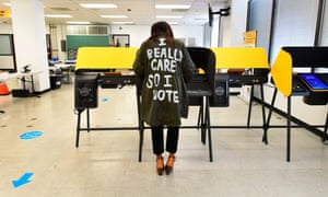 "Tonya Swain votes in Norwalk, California, while wearing a coat that mimics one worn by Melania Trump in 2018 which read, ""I really don't care. Do u?"""