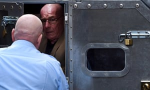 Former detective Roger Rogerson is escorted to a prison van