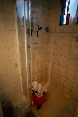 Shower set up for using rainwater to rinse off river water at Lauren Blunden's house.