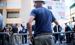 A pro-Trump supporter holds a firearm in Phoenix