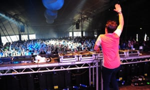 The crowd jumps for a DJ at Creamfields in 2012.